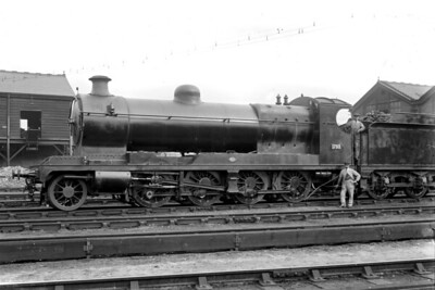 An undated view of Robincon designed 8K class 2-8-0 no. 1733 at Strawberry Hill shed on the LSWR. 1733 was one of the batch purchased by the ROD (Railway operating Department) and was one of 17 loaned to the LSWR where their operational range was limited by the length of the wheelbase. The following notes are taken from Rowledge's tome: ROD 1733 was built by Robert Stephenson with works number 3760 in 1919. Delivered to the LSWR in late January 1920 and allocated to Eastleigh shed. Returned to the War Department by mid-1920 and stored at Stratton near Swindon. Sold in 1925 to the GWR who initially numbered it 3034. Later renumbered 3084 and finally withdrawn in July 1930. [Mike Morant collection]