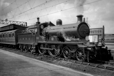 LBSCR, RJ Billinton B4 class 4-4-0 no. 59, on the Up Fast line at Clapham Junction, awaits departure for Victoria on 3/8/1920. No. 59 would become a bit of an oddity. It had been built by Sharp Stewart in August 1901 entering service with the name Baden Powell. However, the Southern at Eastleigh had dismantled no. 59, by then 2059, in 1935 and also no. 2068 of the same class but the pair were reassembled as a single locomotive numbered 2068 and so 2059 was officially withdrawn as a result. [H. C. Casserley / Mike Morant collection]