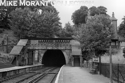 Upper Sydenham on the Crystal Palace (High Level) branch taken on 13/7/54 exactly a week before the branch's closure. This view is looking north towards the Crescent Wood tunnel mouth. [H. C. Casserley / Mike Morant collection]