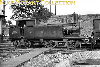 This excellent glass negative isn't only about the locomotive-GER Holden S44 class 0-4-4T no. 1133-but also the location which is the rarely depicted Fairfield Yard, East Croydon shown here circa 1910. No. 1133 was a Stratford product that had entered GER service in December 1900 and would be reclassified as class G4 with the number 8133 by the LNER after the grouping. However, it wasn't a long-likved engine as withdrawal would come in April 1929. Fairfield Yard was originally he pathway to Croydon Central station which finally closed to all traffic on 1/9/1890 with the branch being truncated to end at Park Lane. The yard would eventually be used as a base for the LBSCR's PW department and would be closed completely in 1933 with the removal of the awkardly sited junction immediately to the south of the George Street overbridge. The site would eventually become home to the famed Fairfield Hall. [Mike Morant collection]
