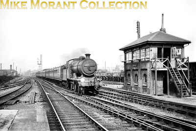 An unidentified LBSCR B4X 4-4-0 still sporting grey livery passes Hove West signal box before drawing to a halt at Hove station. Note the two Pullman cars one of which has a clerestory roof. [Mike Morant collection]