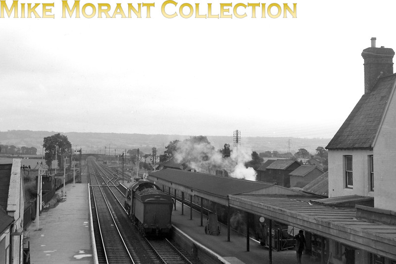 A panoramikc view taken from the footbridge at Sidmouth Junction station looking towards Honiton in the mid-fifties. An S15 runs light on th Down road a an ivatt Mickey mouse 2-6-2T recently arrived from Sidmouth simmers in th bay platform. Sidmouth Junction closed to passenger trafic on 6/3/1967 when the Sidmouth branch closed but the growth of housing developments in thy area prompted reopening by BR on 5/5/1971 but renamed to Feniton.<br> [<i>Mike Morant collection</i>]