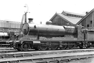 An unusual subject to see on the LSWR in the form of Robinson '8K' class 2-8-0 no. 2119 in steam at Eastleigh mpd on 28/5/1921. No. 2119, that was its ROD or Railway Operating Department number, was built by the North British Loco Co with works no. 22209 and delivered in August 1919 to the War Department. It was sent to the LSWR on loan in November 1919, one of 17 locos loaned to the LSWR. The following notes have been copied from Rowledge's tome:  Returned by the LSWR to the War Department and stored at Stratton near Swindon by July 1920. Sold in 1923 to J A Brown of Australia for use on the Richmond Vale Railway in New South Wales which connected their coal mines to the mainline. The loco was not actually shipped until early 1926 and was No. 13 in Brown's fleet. It was last used in March 1972 and scrapped in September 1973.  [H. C. Casserley / Mike Morant collection]