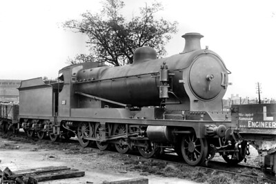 An unusual subject to see on the LSWR in the form of Robinson '8K' class 2-8-0 no. 2120 in store at Strawberry Hill mpd on 14/5/1921. No. 2120, that was its ROD or Railway Operating Department number, was built by the North British Loco Co with works no. 22210 and delivered in August 1919 to the War Department. It was sent to the LSWR on loan in November 1919, one of 17 locos loaned to the LSWR. Two locos left in March 1920 and another two in June. The remainder were stored by July 1920 and were later moved to Stratton near Swindon. Subsequently it was purchased by the GWR in June 1925 and numbered 3096. It was one of the batch with short working lives with the GWR being withdrawn in March 1929. [H. C. Casserley / Mike Morant collection]