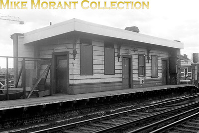 An undated view on a dull day showing a structure at East Brixton station on the SLL (South London Line) netgween Victoria and London bridge via Peckham Rye. Opened as Loughborough Park station by the LBSCR on 13/8/1866, East Brixton was renamed Loughborough Park and Brixton on 1/1/1870 but was renamed again to East Brixton on 1/1/1894. The station was closed by BRB on 5/1/7976.  [Mike Morant collection]