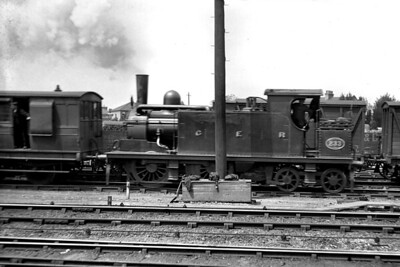 This undated glass negative isn't only about the locomotive-GER, Massey Bromley, E10 class 0-4-4T no. 233-but also the location which is East Croydon or, more correctly for the period, New Croydon. No. 233 was attributed to the little known GER Locomotive Superintendent, Massey Bromley, and had entered GER service in 1880. It was rebuilt in 1891 and withdrawn in 1906. [E. T. Vyse / Mike Morant collection]