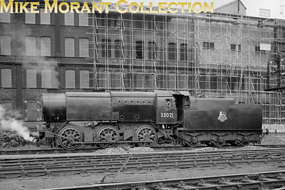 Commendably clean Bulleid Q1 class 0-6-0 no. 33021 at Stewarts Lane on 4/3/57. Thios was probably a decent 'cop' for the spotters because 33021 was an Eastleigh engine throughout the BR era and was withdrawn there in August 1963. [Mike Morant collection]
