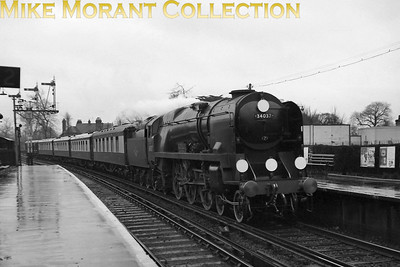 Rebuilt Bulleid West Country pacific no. 34037 Clovelly on royal train duty passing through Staines station on a dull and wet 28/3/58. [Mike Morant collection]