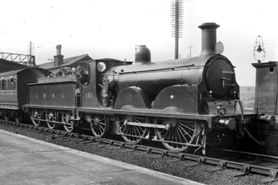 LBSCR, Stroudley designed B1 'Gladstone' class 0-4-2 no. 191 prepares for departure with a Victoria bound train in the Up Fast platform at Clapham Jct. on 20/3/1920. No. 191 was of 1888 vintage and would be withdrawn in December 1927. [H. C. Casserley / Mike Morant collection]