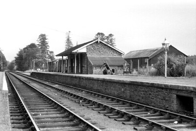 Petrockstow station on the North Devon & Cornwall Junction Light Railway. This negative isn't dated but I suspect that it was taken after the line's closure to passenger traffic in 1965. The shiny rails might confuse the viewer but that is correct as this, the northern end of the line, continued to be used by china clay traffic until 1982. The trackbed here has long been part of the Tarka Trail. [Mike Morant collection]