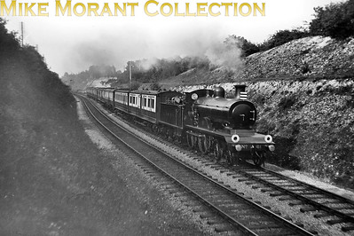 A 1908 picture of the Down Sunny South Express ,comprising LNWR stock in LBSCR territory at Star Lane (Hooley) on the Quarry Line, in the charge of RJ Billinton B4 class 4-4-0 no. 61. [Mike Morant collection]