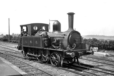 Isle of Wight Central Railway 2-4-0T no. 5 at Sandown station on 2/6/1921. No. 5 was a Beyer Peacock product with works no. 1584 that had entered IWCR service in June 1876 and would be withdrawn in April 1926. [Mike Morant collection]