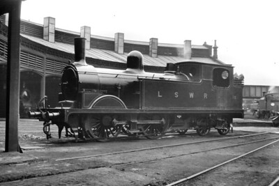 LSWR, Adams designed T1 class 0-4-4T no. 18 on shed at Guildford on 24/9/1921. Built at the LSWR's Nine Elms works, no. 18 had entered service in September 1895 and would be withdrawn in May 1935. [H. C. Casserley / Mike Morant collection]