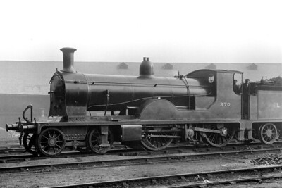 Drummond's second attempt to design a 'double-single' 4-2-2-0 was the E10 class of just five locomotives and this is no. 370 which was the second that was built at Nine Elms works entering service in June 1901 and depicted here at Nine Elms shed on 3/1/1924. The class was not a success and all were withdrawn in 1926/27 with 370 succumbing in September 1926.  [H. C. Casserley / Mike Morant collection]