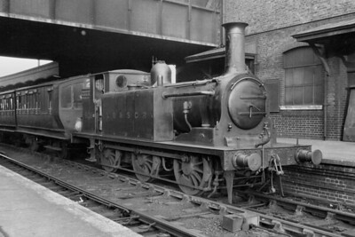 LBSCR, Stroudley E1 class 0-6-0T no. 606, in charge of 4-wheeled passenger stock, stands in platform 17 at Clapham Junction on 12/3/1920. [H. C. Casserley / Mike Morant collection]