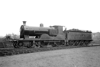LSWR, drummond designed L12 class 4-4-0 no. 425 poses at Nine Elms shed on 10/4/1920. 425 was built at the company's Nine Elms works in November 1904 and would survive to become BR no. 30425. Withdrawal came at Eastleigh mpd in August 1951. [H. C. Casserley / Mike Morant collection]