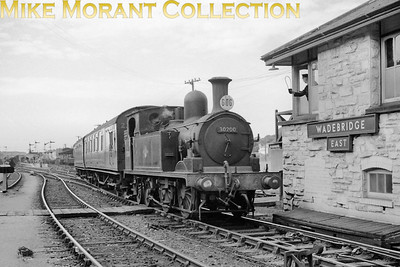 Adams 'O2' class 0-4-4T no. 30200 passes Wadebridge East 'box on 4/7/57. 30200 was a Wadebridge engine from nationalisation until February 1961. Withdrawal came in August 1962 at Plymouth Friary mpd. [Mike Morant collection]