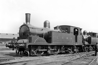 LSWR, Adams T1 class 0-4-4T no. 8 at Nine Elms shed on 6/5/1922. Built at Nine Elms works in August 1894, no. 8 would be withdrawn in May 1949 whilst allocated to Eastleigh shed. [H. C. Casserley / Mike Morant collection]
