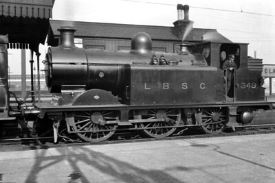 The sole Stroudley D1X 0-4-2T No. 349stands in the Up Main platform at Clapham Junction on 20/3/1920. This engine must have been close to having worn the most numbers in its lifetime starting out as no. 20 in July 1875 and then  - dates not known here  - 78, 79A, 349, 216 and finally SR 2216. She didn't quite accomplish the full set as she was withdrawn in August 1933. [H. C. Casserley / Mike Morant collection]