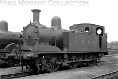 LSWR liveried, Adams designed G6 class 0-6-0T no. 348 poses for the cameraman at Nine Elms depot on 19/6/1925. 348 was a Nine Elms product of 1900 vintage and would be withdrawn at Basingstoke shed in August 1948 still in SR black livery. [H. C. Casserley / Mike Morant collection]