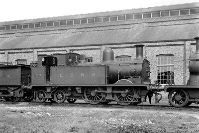 LSWR, Adams designed O2 class 0-4-4T no. 193 at Strawberry Hill shed on 14/5/1921. No. 193 had been built at the LSWR's Nine Elms works in November and would give 72 years of service before withdrawal at Plymouth friary depot in April 1962. [H. C. Casserley / Mike Morant collection]