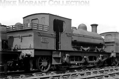 Withdrawn former Rhymney Railway, double-framed 0-6-2ST, bearing its GWR no. 129, at the famed 'Swindon dump' on 11/9/1927. This loco was built by Hudswell Clarke in 1899 and entered service as the RR's 'K' class no. 87. Withdrawal came for this loco as GWR 129 at Cardiff Docks shed in October 1926. [H. C. Casserley / Mike Morant collection]