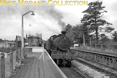 Dated 1963, Churchward 4300 class mogul no. 6345 pauses at South Molton station on th line from Taunton to Barnstaple. 6345 was an 83B Taunton engine when this shot was taken and would remain there until withdrawal on 28/12/63. South Molton and the rest of this branch's stations would close on 3/10/66. [Mike Morant collection]