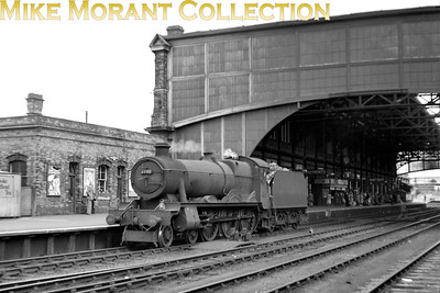 The familiar and imposing structure at Bournemouth Central provides the backdrop for Hawksworth 'Modified Hall' no. 6990 Witherslack Hall in this undated view. The Halls were a familiar sight at Bournemouth as they were frequent visitors in charge of inter-regional services from Oxford. [Mike Morant collection]