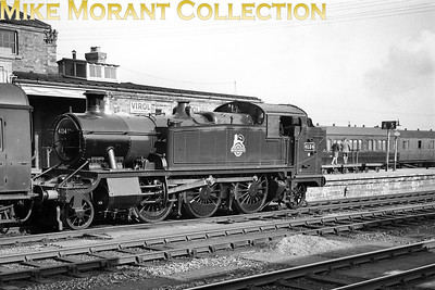 Recently outshopped Collett 5101 class prairie tank no. 4134 at Swindon on what is probably a running-in turn. 4134 has an 87G Carmarthen shed plate and was allocated there from 7/56 thru' 6/60 which brought a move to 87A Neath (Court Sart) where withdrawal would come in May 1963. Note the 'spotters' standing on the barrow on platforms 5/6. [Mike Morant collection]