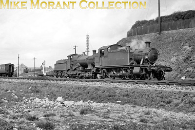 A 1933 view of GWR Churchward 4500 class 2-6-2T no. 5569 and an unidentified Dean 'Bulldog' class 4-4-0 at Weymouth mpd. [H. N. Shepherd / Mike Morant collection]
