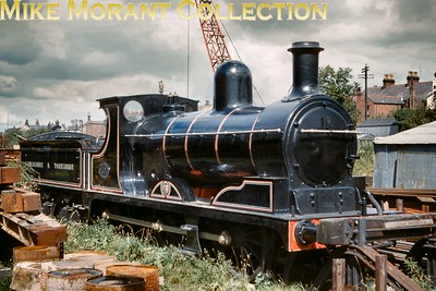 Preserved L&YR Aspinall designed '27' class 0-6-0 no. 1122 stored in the yard at White Bear station on 15/8/61. This loco had been built at Horwich and entered service in January 1896 as LYR no. 1300 and survived well into the BR era and was withdrawn as BR no. 52322 at Lees (Oldham) shed in August 1960. Storage and initial preservation were conducted at White Bear (Adlington) station yard where 1122 remained until a move to Carnforth where its identity was correctly changed to no.  1300. Background data has been a bit sketchy but it seems that 1300 is currently, in August 2019, owned by Andy Booth and resides at the East Lancashire Railway. [W. Potter / Mike Morant collection]