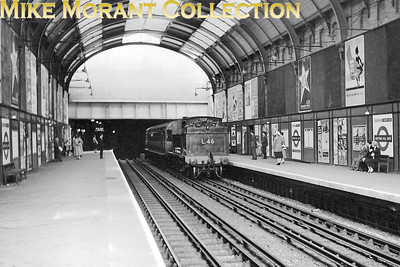 SLS: Hammersmith & City and Inner Circle Rail Tour 22/9/57 London Transport 'E' class 0-4-4T no. L46 hauled this tour train bunker first from Edgware Road, negotiated much of the Circle Line anti-clockwise to Baker Street and is seen here passing through Notting Hill Gate station. [Mike Morant collection]