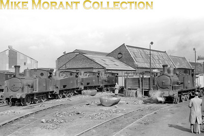 Manchester Ship Canal 0-6-0T's lined up at Mode Wheel depot, Salford, on 12/4/59. They are, from ledt to right ...... No. 22 HE 778 (Jazzer) No. 71 HC 1465 (long tank) No. 64 HC 1240 (long tank) No. 35 HC 701 (short tank) No. 30 HC 663  (short tank) [Mike Morant collection]