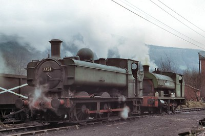 Former GWR, Collett 5700 class 0-6-0PT no.7754 in steam at Mountain Ash colliery on 20/2/75. 7754 would blow a cylinder cover in the following May and despite that and many more shortcomings would become a much-rebuilt but loved heritage engine in residence at the Llangollen Railway. [Mike Morant collection]