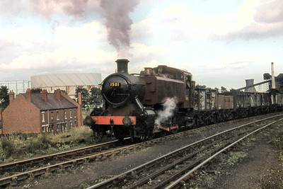 Hawlsworth 1500 class 0-6-0 pannier tank no. 1501, in unlined red livery but still wearing a BR smokebox number plate, in industrial service at Coventry colliery' sThree Spire sidings on 19/7/62. 1501 had been withdrawn by BR in January 1961 and was one of a trio of the class bought out of service by the NCB with all three remaining in service until 1970. [Mike Morant collection]