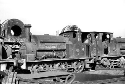 Withdrawn McAlpine inside cylinder 0-6-0ST no. 32 awaits the cutter's torch at Hayes on 8/7/59. No. was a Hudswell Clarke product of 1913 with works no. 1028. Withdrawal came circa July 1956. [H. C. Casserley / Mike Morant collection]