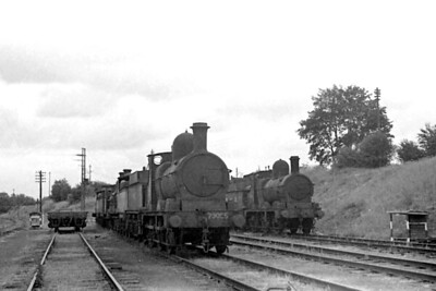 Not the best of negatives but the subject matter is too good to bypass for that reason. The location is Hookergate on the Shropshire and Montgomeryshire Railway photographed in fading light on June 21st, 1948 and the two leading locomotives are both former GWR 2301 'Dean Goods' class 0-6-0's with WD no. 70095 on the left and 70093 on the right. 70095 had been GWR no. 2470 whilst 70093 was no. 2433 and both were requisitioned by the War department in December 1940 with neither returning to capital stock after the war ended. [H. C. Casserley / Mike Morant collection]