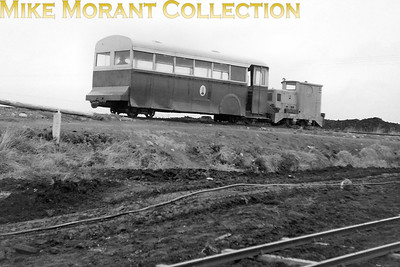 Irish bog railways, Bord na Mona at Timahoe, during an REC visit in September 1957. The loco is LM 75, a Ruston 40DL, which still survives dumped on Lullymore Bog not that far from where it was first used at Timahoe Works. The coach is a converted DUTC Leyland Royal Tiger Cub bus body, built by the DUTC in Inchicore in Dublin in the mid 1930s. BNM bought two such bodies from DUTC in about 1949 and mounted them up as shift coaches. Shift coaches were used to take out the workers to the working area and they were occasionally used for tours by visiting groups or enthusiasts. [Mike Morant collection]