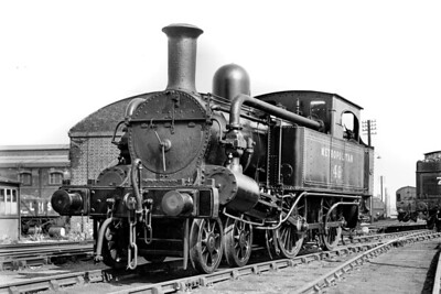 Immaculate Metropolitan railway, Beyer Peacock built 'A' class 4-4-0T at the Met's Neasden Shed on 12/5/1934. No. 49 dated from 1870 wand would be withdrawn and scrapped in 1936. [H. C. Casserley / Mike Morant collection]