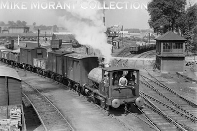 Bass brewery 0-4-0ST no. 11, with 14in x 21in cylinders and 3ft 6in driving wheels, at Shobnall Jct. on 27/6/1933 and obviously posed fpr the cameraman. No. 11 was built by Neilson Reid with works no. 5568 and entered service at Bass 10/8/1899. The end of its life saw no. 11 stored at Worthington Old Engine Shed in 1963 Followed by its sale to Thos W. Ward Ltd., Sheffield for scrap on 14/7/1964. [H. C. Casserley / Mike Morant collection]