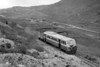 A September 1957 shot of CDRJC railcar no. 20 during a photo opportunity in the Barnsmore Gap with Killybegs Harbour visible in the distant background. No. 20 is of 1951 vintage and was sold, along with sister railcar no. 19, to the Isle of Man railway when the CDR closed in 1959.<br> [<i>Mike Morant collection</i>]