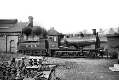 Commendably clean NCB, National Coal Board, 0-6-0 tender engine no. 5 at Whitburn colliery on 29/4/52. No. 5 originated on the NER and was a Fletcher designed '398' class loco built at the NER's own Gateshead works in 1881 entering NER service with the fleet number 396 and was modified with the Worsdell boiler that we see in this shot in 1901. No. 396 was sold out of service to the Harton Coal Company in 1925 becomi9ng its no. 5 and it became known to enthusiasts for its exploits hauling The Marsden rattler which was the company's passenger service for its employees. The pseudo-Worsdell cab was a post-LNER addition and a viewer has noted that the tender frames aren't original either. Withdrawal for no. 5 came in 1953. [R. M. Casserley / Mike Morant collection]