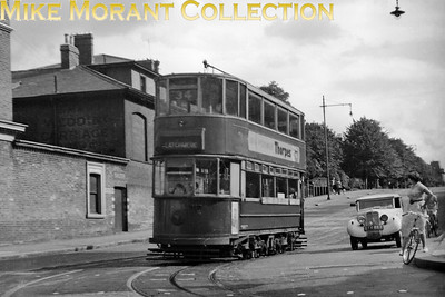 London Transport E/1 tram car no. 1395 Latchmere bound on service 34 taken on 27/8/1950 at Cedars Road, Lavender Hill. In March, 1950, a collier hit and damaged Battersea Bridge cutting off the service 34's Chelsea terminus with the service cut back to the south side of the Bridge by the Latchmere' public house. [A. A. Jackson / Mike Morant collection]