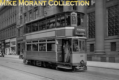 Glasgow Corporation Tramways 'Kilmarnock bogie' car no. 1105 photographed on 21/5/62 eastbound on St. Vincent Street passing the columns of the Bank of Scotland Head Office with the United Provident Building sign just visible above the roof of the tram. The entire tramway system in Glasgow would come to an emotional end on the following 4th September. [Mike Morant collection]
