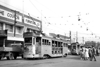 Brisbane City Council 'Dropcentre' or 'Droppie' tram car no. 360 operates the Fortitude Valley to Belmont route on December 12th, 1956. This was obviously a busy route as there are two more 'Droppies' in the background. The Brisbane tramway system came to an end on April 13th, 1969. [Mike Morant collection]
