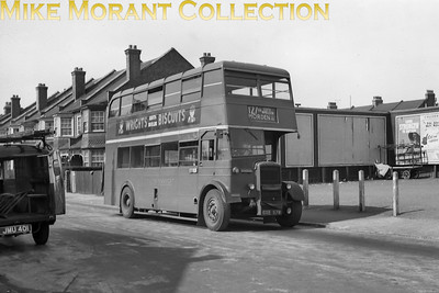 London Transport Duple bodied lowbridge Daimler bus no. D2, registration no. GXE 579, on route 127 at Milner Road, South Wimbledon. D2 had been built built in 1944 and was allocated to AL Merton garage from new. It had a relatively short working life and was withdrawn in December 1952 followed by export to the South Western Omnibus Co. in Ceylon in the following month. This negative isn't dated but the livery, red with cream band, limits the date range to 1951/52. [Mike Morant collection]