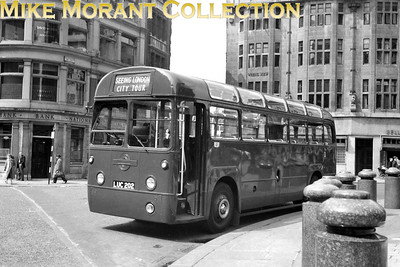 London Transport, private hire RF2 takes a rest during sight seeing suties in the City of London. RF2 is in the less than glamorous later plain green livery which was applied circa May 1953 whilst allocated to Camberwell garage. [Mike Morant collection]