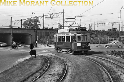 De Blauwe Tram-The Blue Tram Noord-Zuid-Hollandsche Tramweg Maatschappij-NZHVM NZH car no. A.320. on a service to Oegstgeest, is about to duck under the relatively new railway viaduct at Stationsplein in Leiden on 16/5/59. [Mike Morant collection]