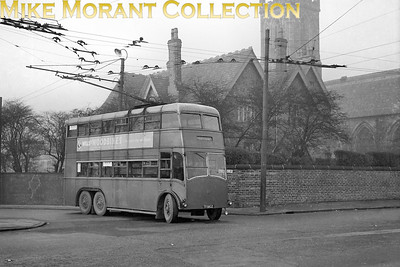 South Lancashire Transport trolleybus Fleet no.: 23 Registration: TF 5802 Chassis: Guy BTX Body: Roe Entered service: 1931 Withdrawn: 1958 Taken at Swinton, and is turning out of Vicarage Road into Partington Lane with a service for Atherton. St. Peters  Church & Vicarage are in the background. [Mike Morant collection]