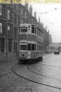 The unique Glasgow Corporation Transport 'Horonation' bogie tram car no. 1100 outside Partick's Hayburn Street depot on 4/4/58. This oddity was preserved by the TMS at Crich and is stored pending further restoarion as at 29/11/2019. [Mike Morant collection]